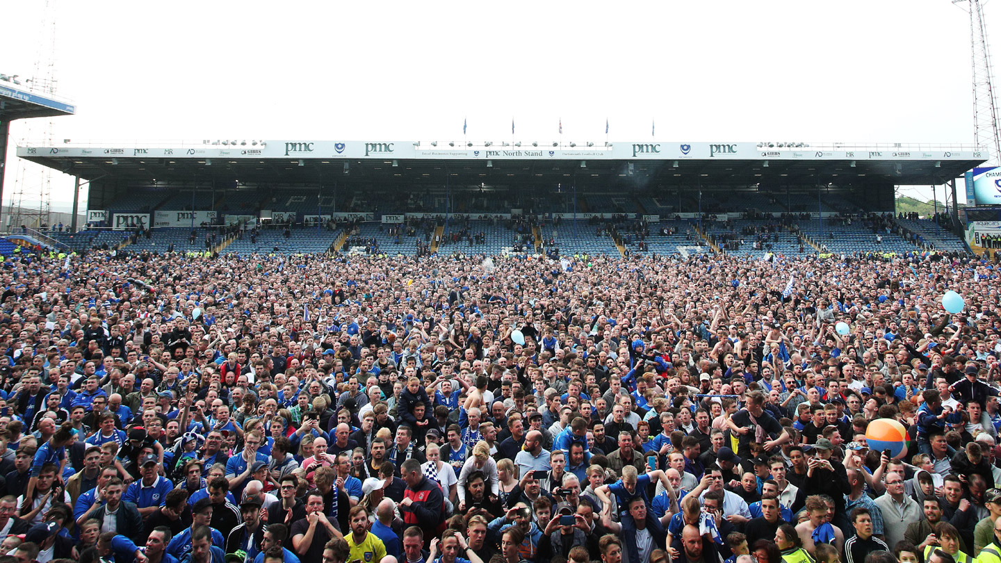 Pompey fans celebrate at Fratton Park after the League Two title is secured