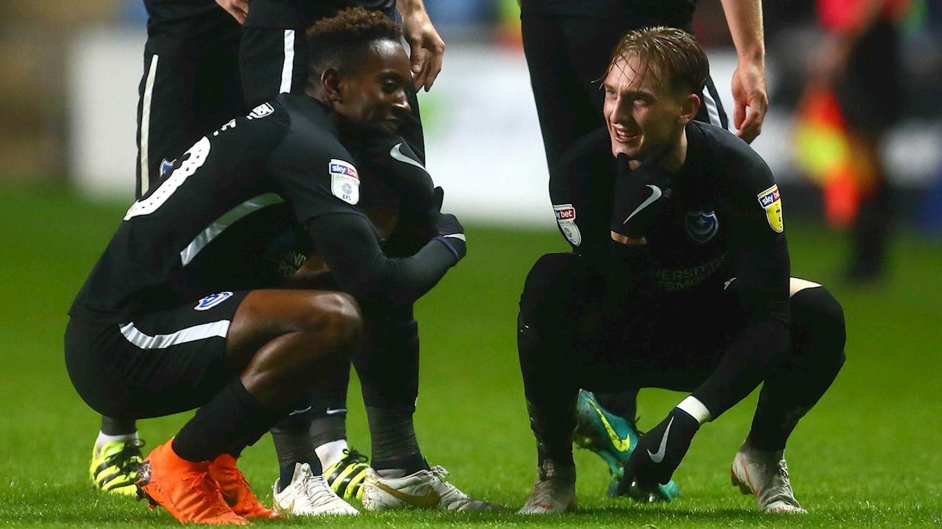 Ronan Curtis celebrates with Jamal Lowe after scoring for Pompey at Coventry