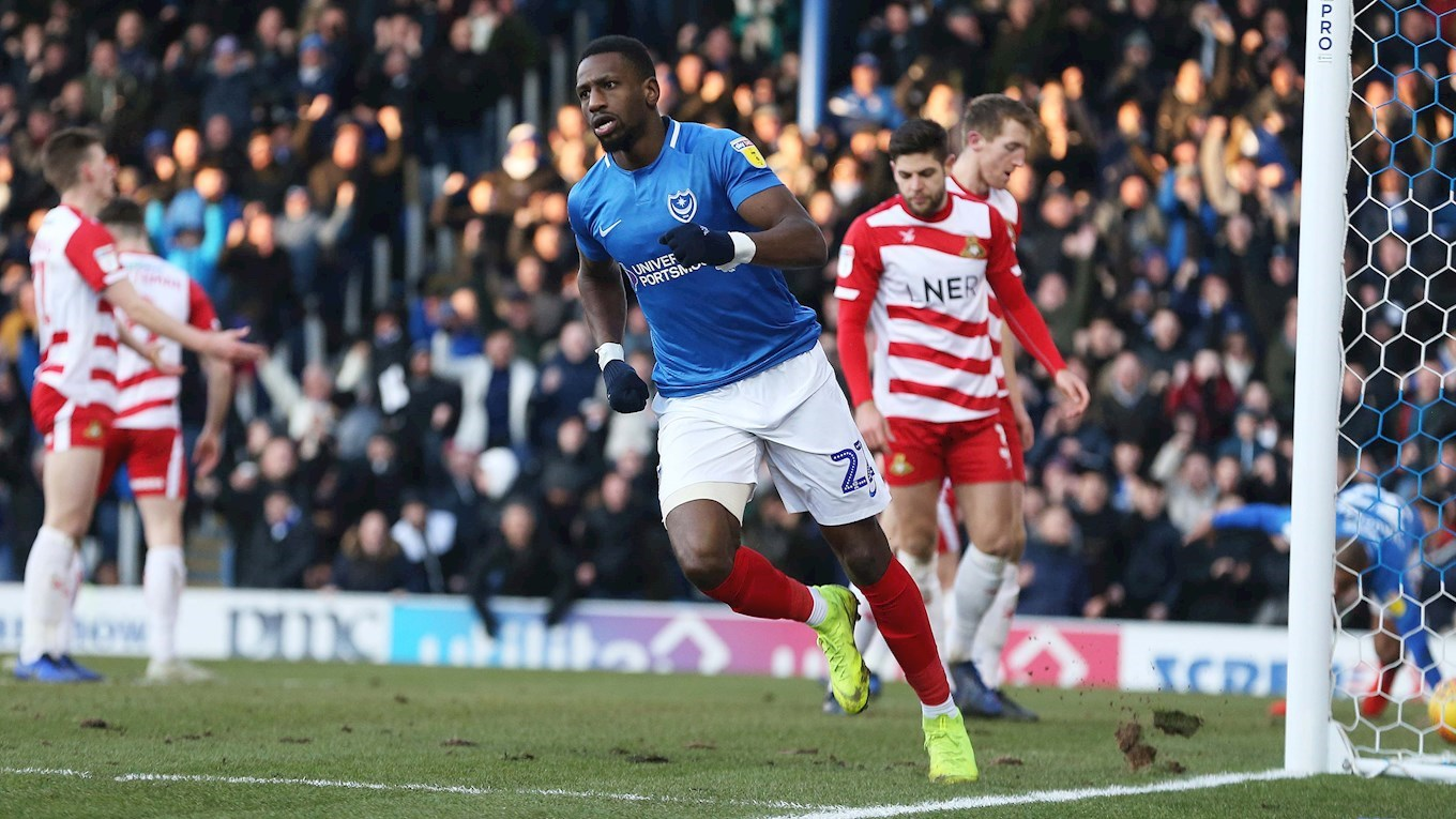 Omar Bogle celebrates scoring for Pompey against Doncaster