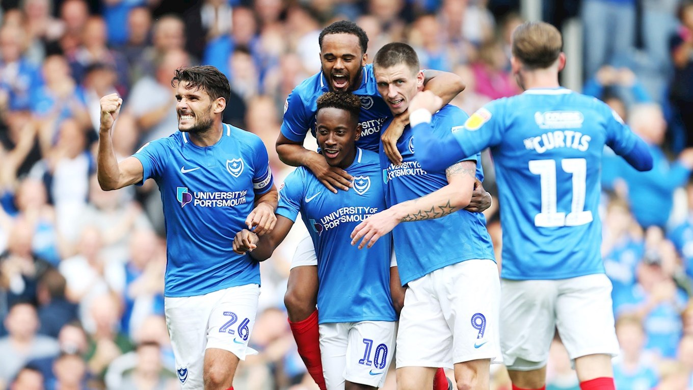 Pompey celebrate scoring against Oxford Unit