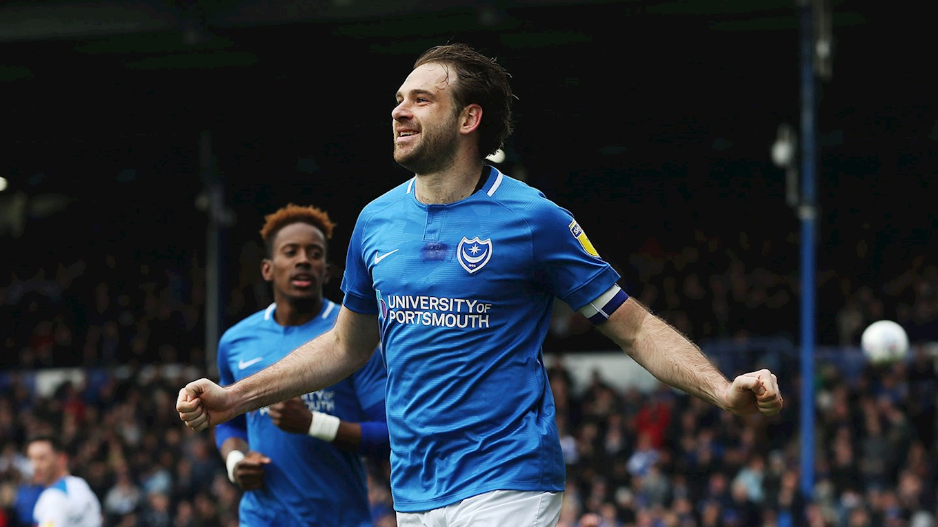 Brett Pitman celebrates after scoring for Pompey against Rochdale
