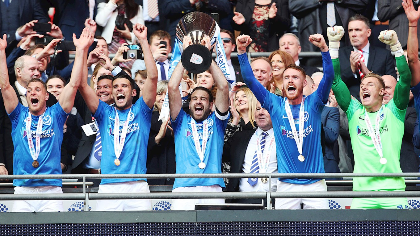 Brett Pitman lifts the Checkatrade Trophy for Pompey at Wembley