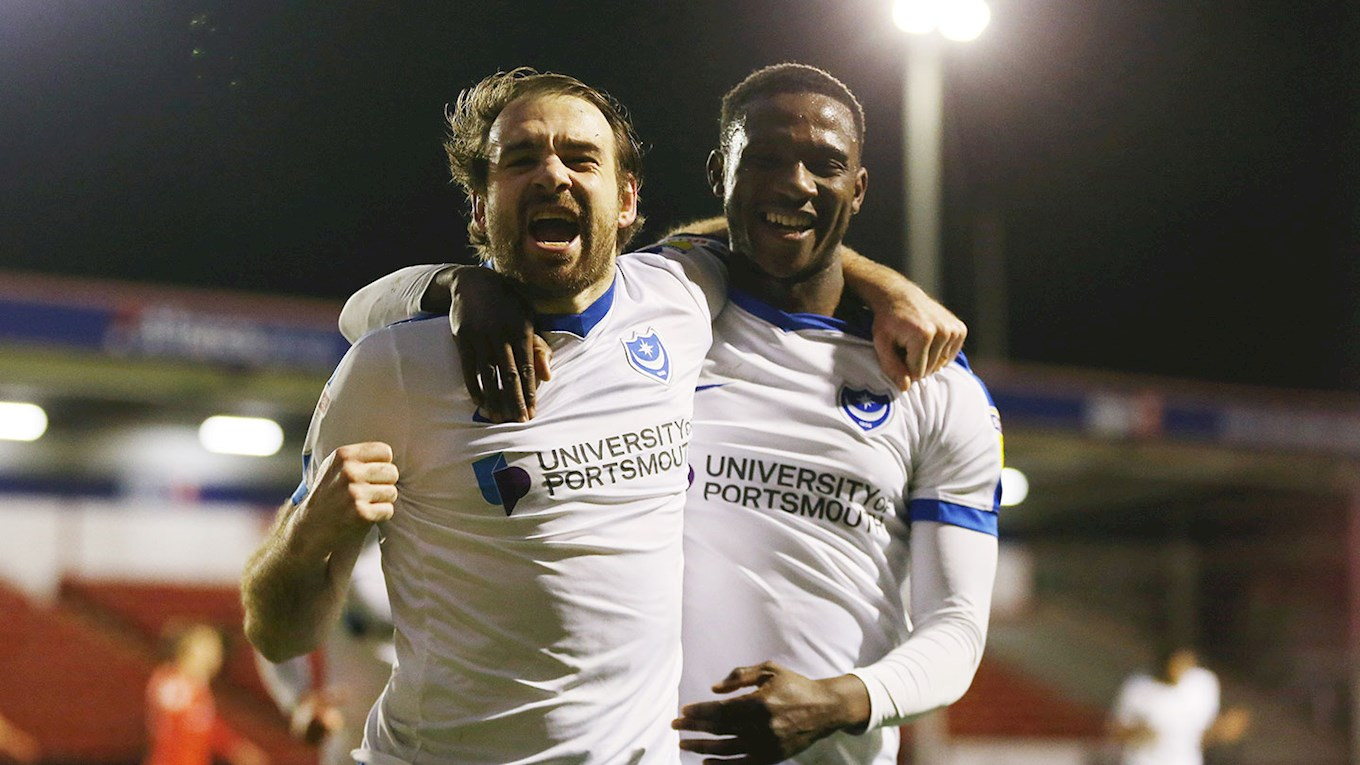 Brett Pitman celebrates with Viv Solomon-Otabor after scoring for Pompey at Walsall