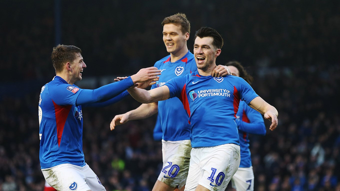 John Marquis celebrates scoring for Pompey against Barnsley in the Emirates FA Cup