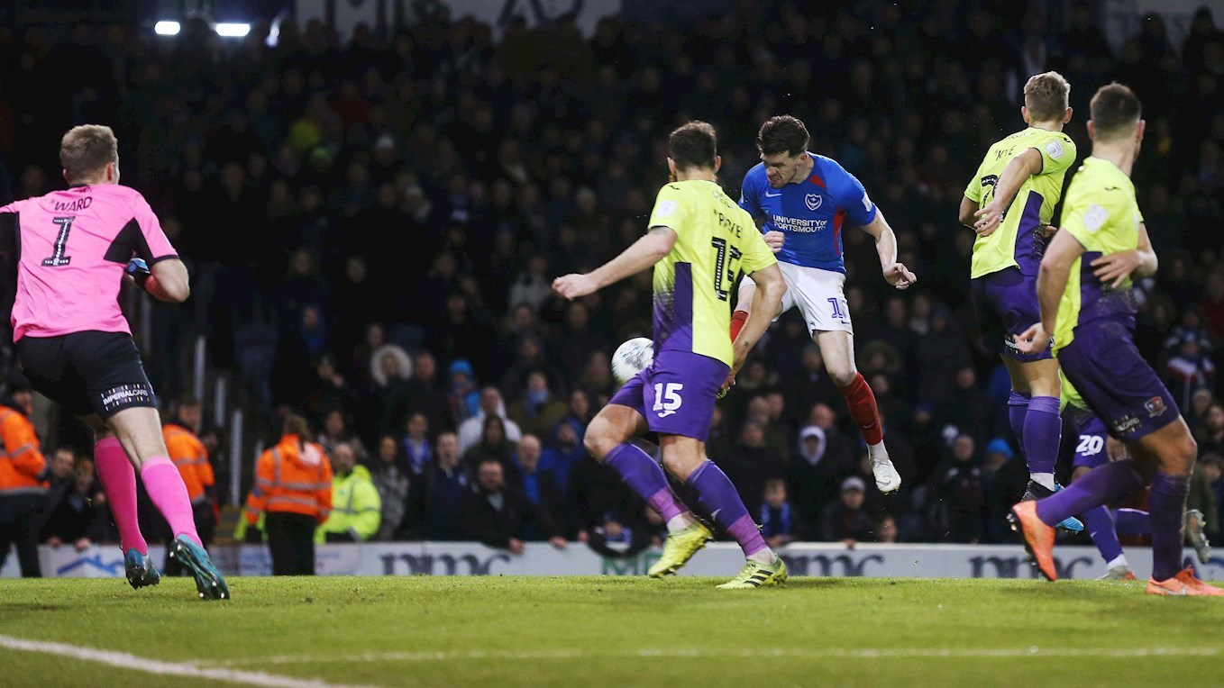 John Marquis scores for Pompey against Exeter