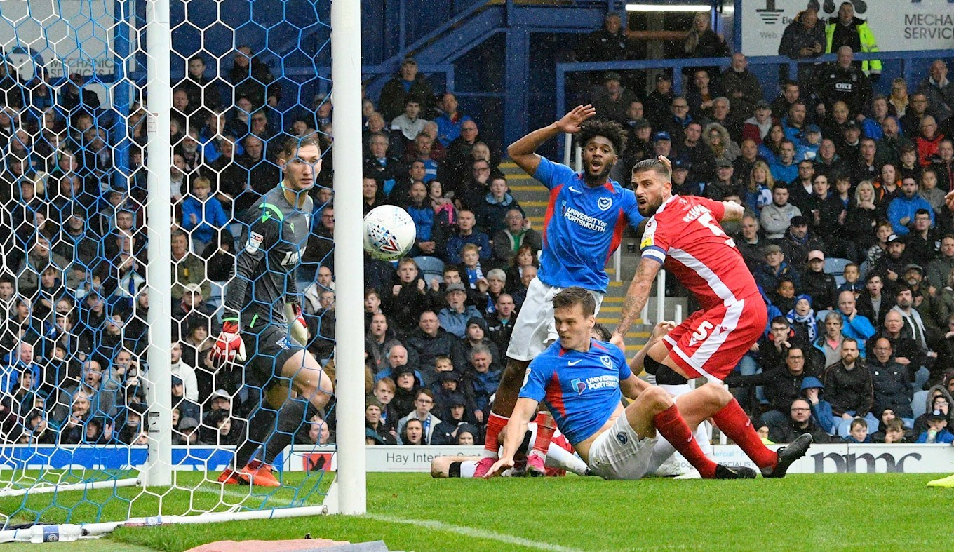 Sean Raggett hits the post for Pompey against Gillingham