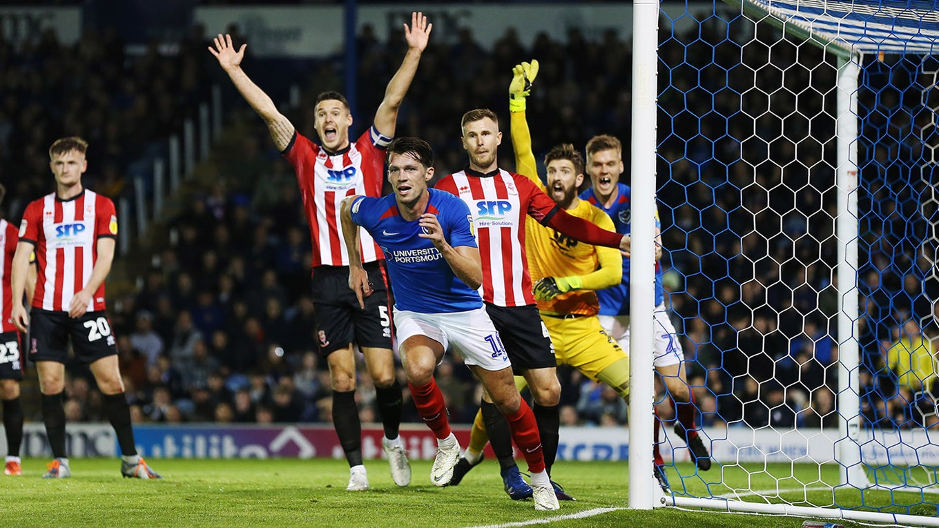 John Marquis celebrates scoring for Pompey against Lincoln