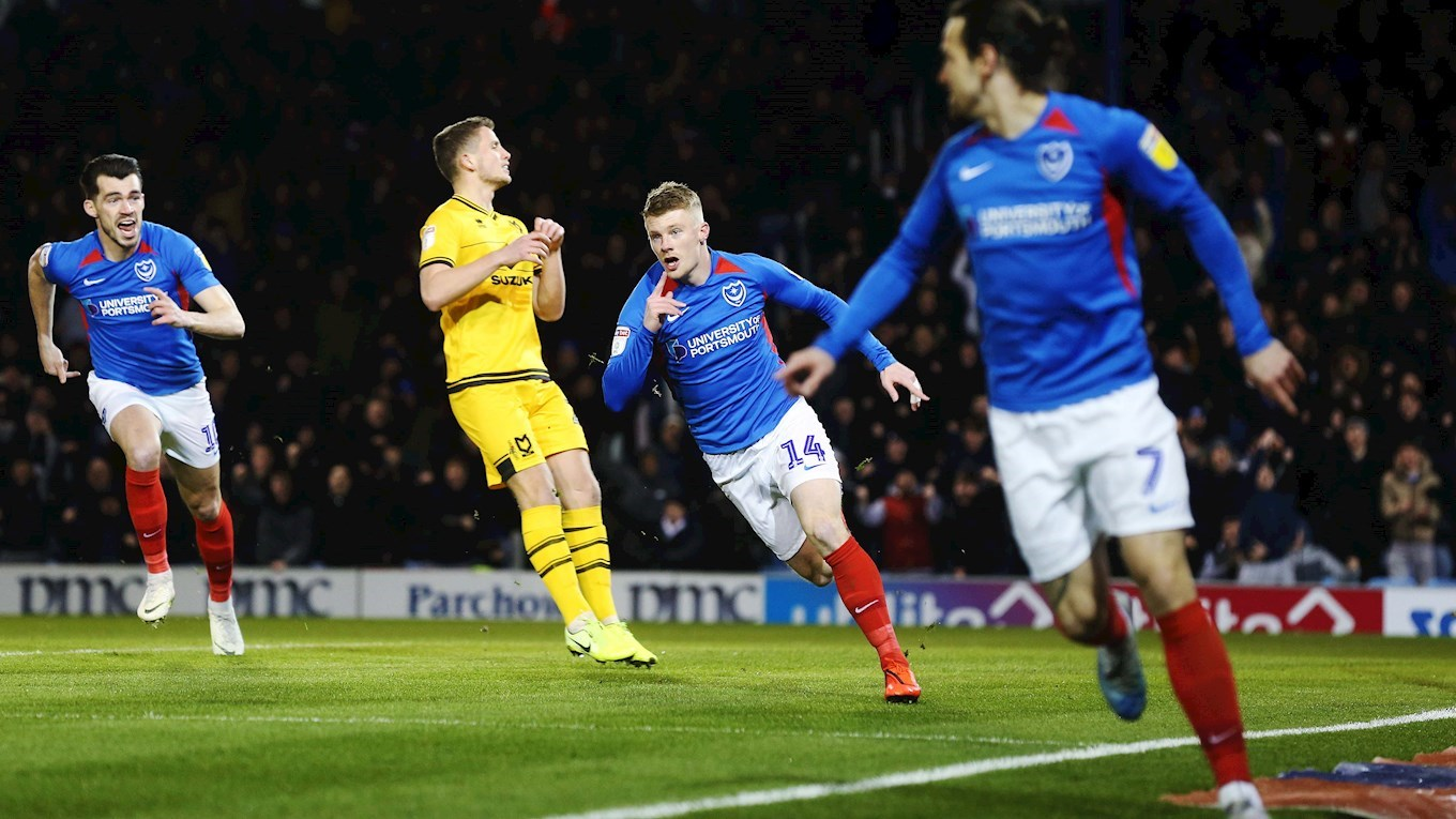 Andy Cannon celebrates scoring for Pompey against MK Dons