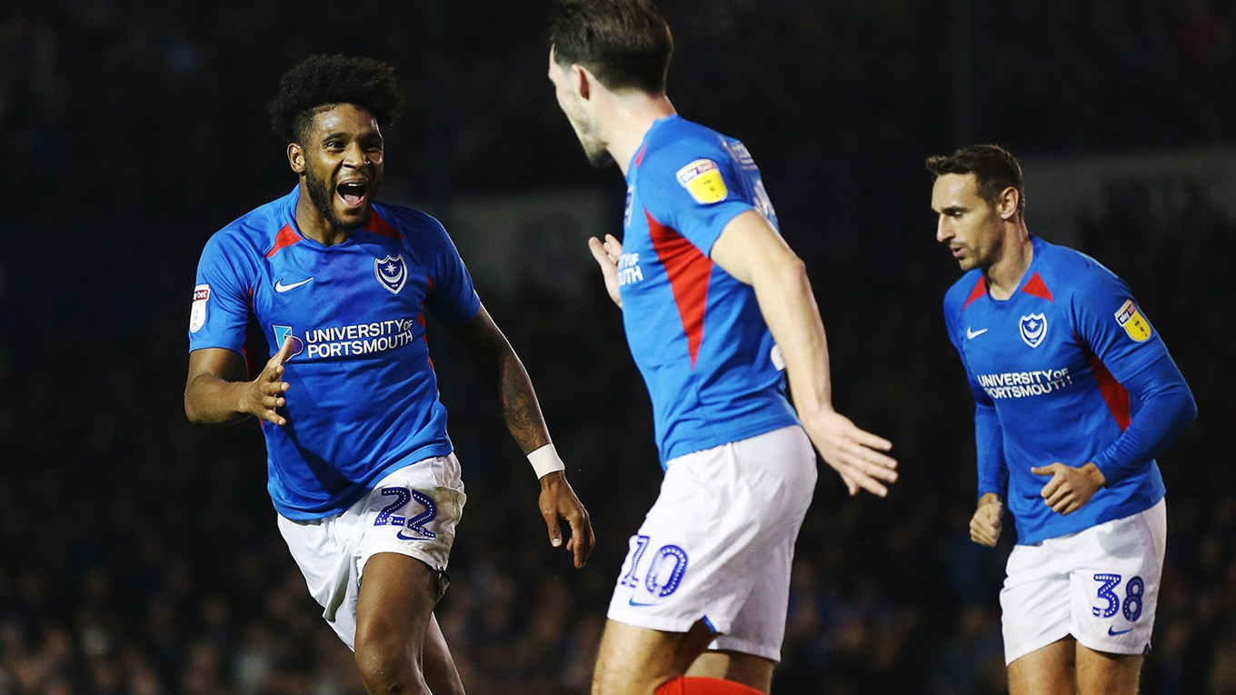 John Marquis celebrates scoring for Pompey against Rotherham United