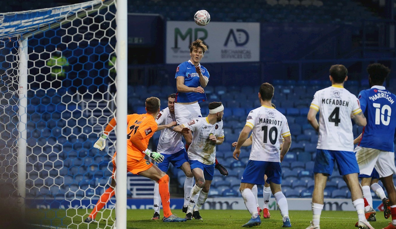 Sean Raggett scores for Pompey against King's Lynn in the Emirates FA Cup at Fratton Park