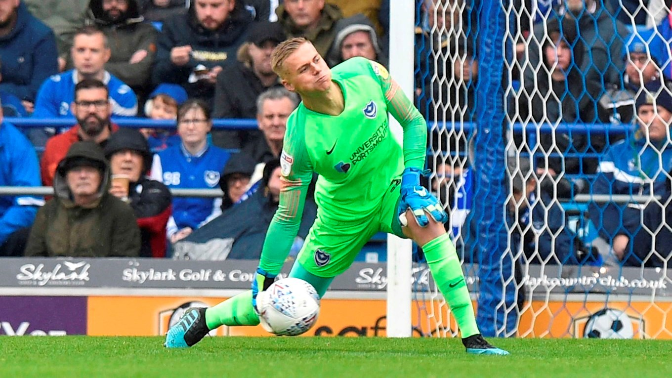 Alex Bass in action for Pompey against Gillingham
