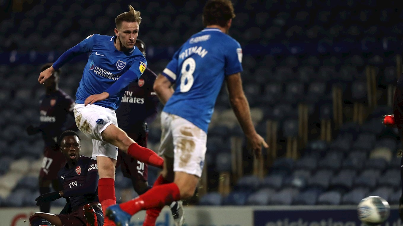 Adam May in action for Pompey against Arsenal