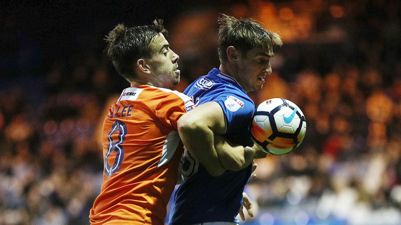 Pompey defender Brandon Haunstrup in action at Luton Town