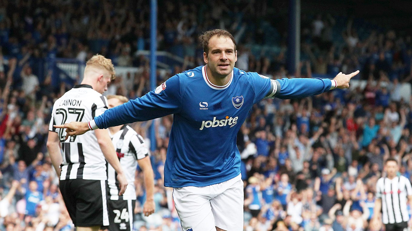 Brett Pitman celebrates scoring for Pompey against Rochdale at Fratton Park in Sky Bet League One