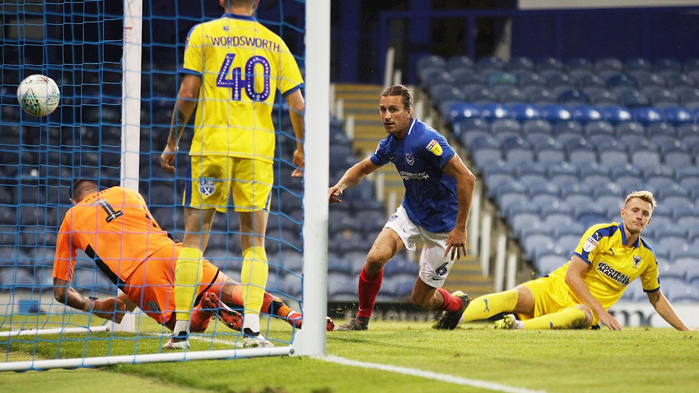 Christian Burgess scores for Pompey against AFC Wimbledon