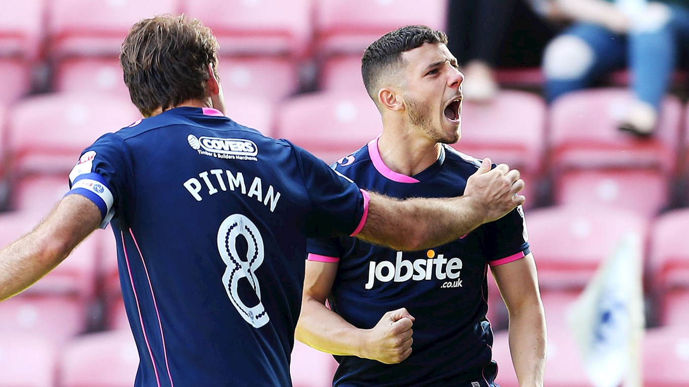 Conor Chaplin celebrates scoring for Pompey at Wigan