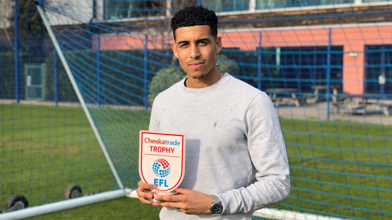 Louis Dennis with his Checkatrade Trophy Player of the Round award