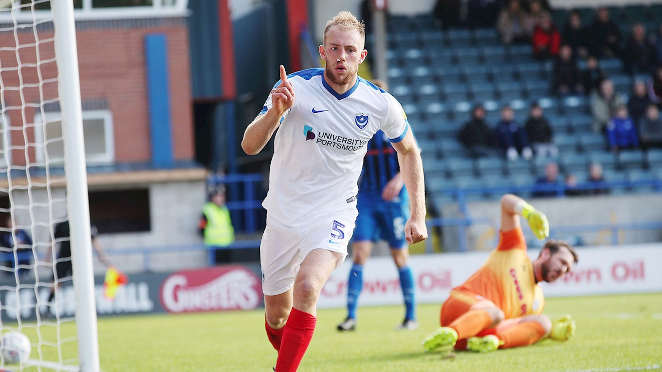Matt Clarke celebrates scoring for Pompey at Rochdale