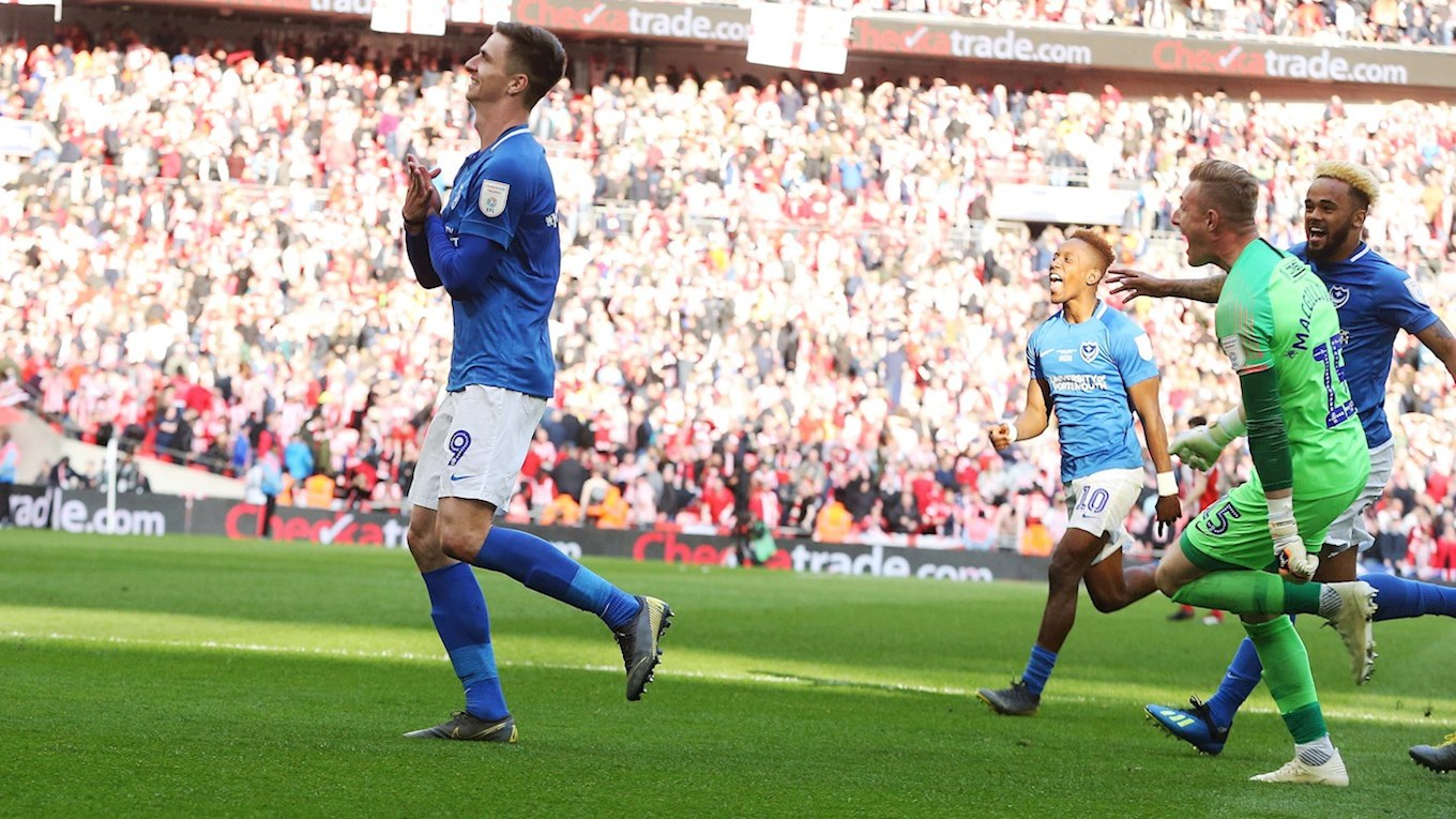 Oli Hawkins celebrates scoring the winning penalty for Pompey at Wembley