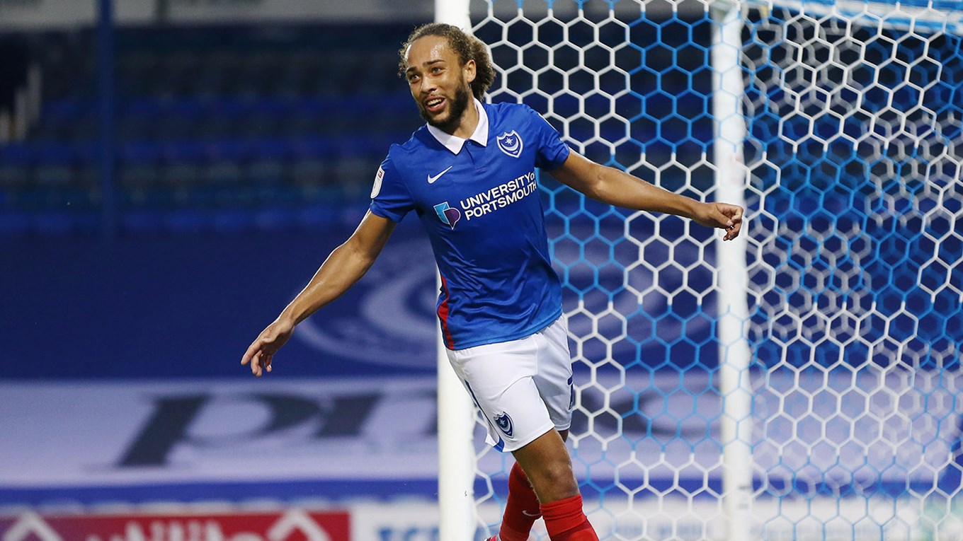 Marcus Harness celebrates scoring for Pompey against Colchester in the EFL Trophy