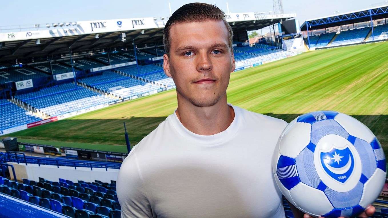 Sean Raggett signs for Pompey