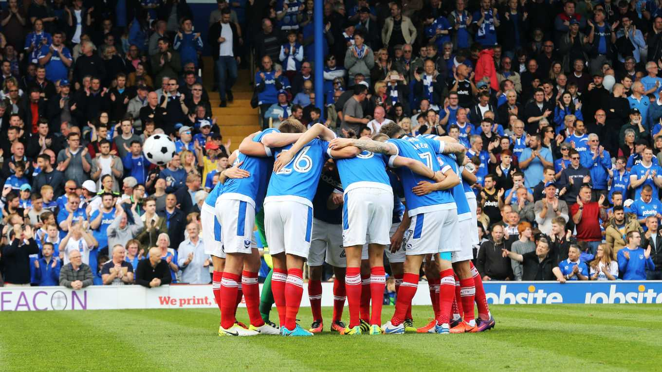 The Pompey team in a huddle at Fratton Park